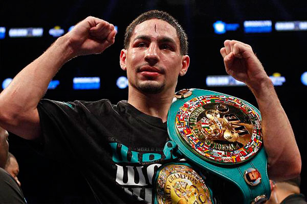 Danny Garcia holding the now-vacant WBC title