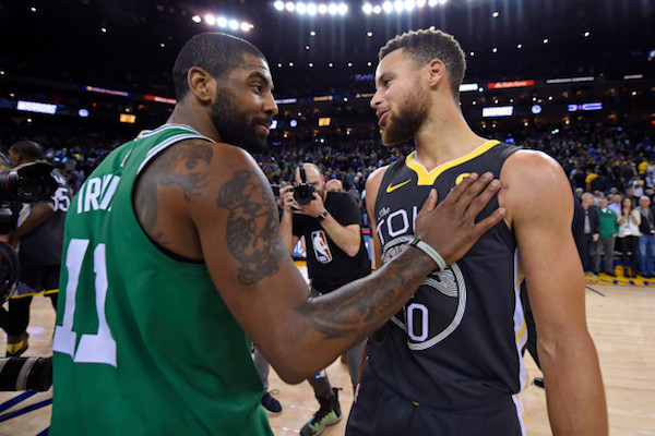 Kyrie Irving and Stephen Curry embrace.